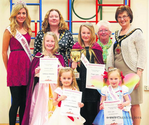 On the back row are Miss Swindon 2014 Catissa Creighton, deputy mayor Sue Hughes, Royal Wootton Bassett Town Rotary Club president Marie Bernhardt and Royal Wootton Bassett mayor Linda Frost. In the middle row are carnival princess Jemma Lynch and carniva
