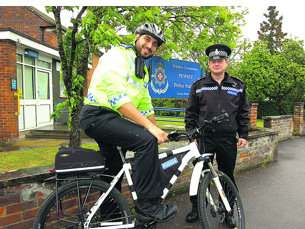 PCSO Joe Sadd shows Sgt Vincent Logue the new electric bike