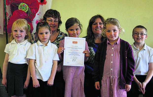 Numeracy co-ordinator Zoe Newman, left, and teaching assistant Sharon Hopkins with pupils