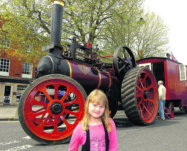 Abigail is pictured in front of a 1914 Marshall steam engine during the May Day Fair in Devizes. (PM232) By Paul Morris