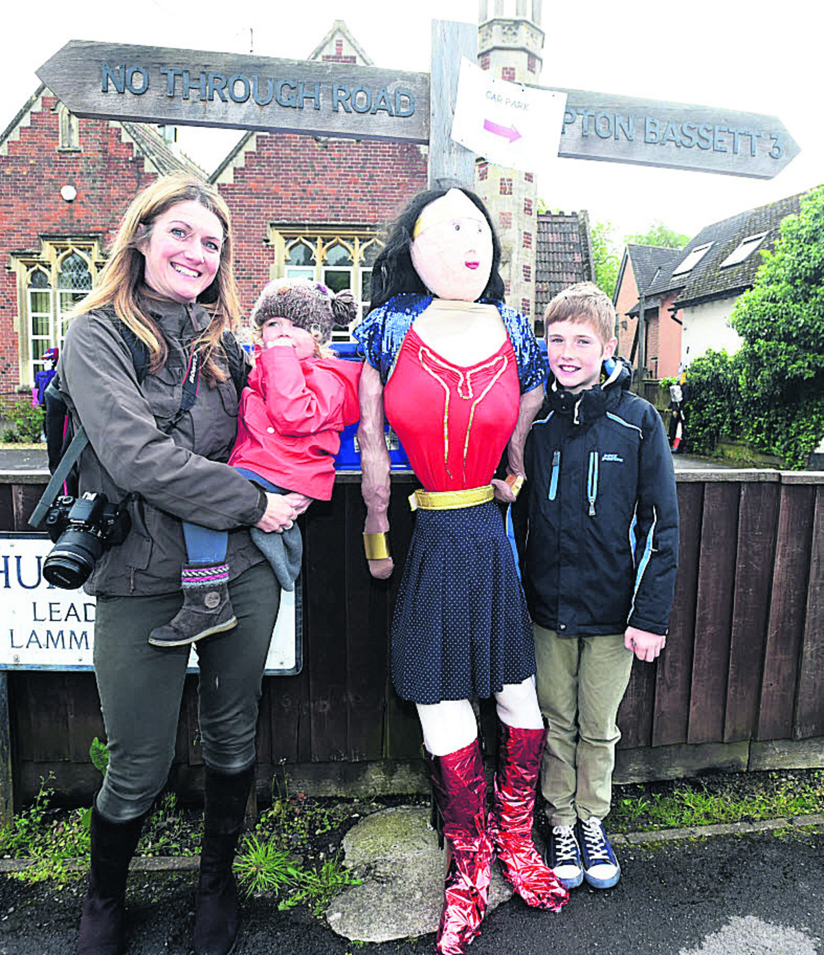 Edith, Errin and Alex Cameron, who arrived from Lower Compton, get to meet Wonder Woman at the signpost