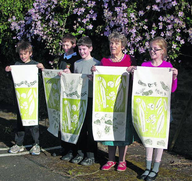 The Wiltshire Gazette and Herald: William Hulme, Edgar Nicolas, William Jacques, Heather Martin and Tilly Egerton with legacy banners created for the Wild Sherston event
