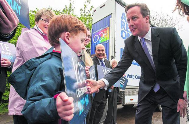 The Wiltshire Gazette and Herald: David Cameron  meets Harry Auty, six, of Malmesbury   (48576) By  trevor porter