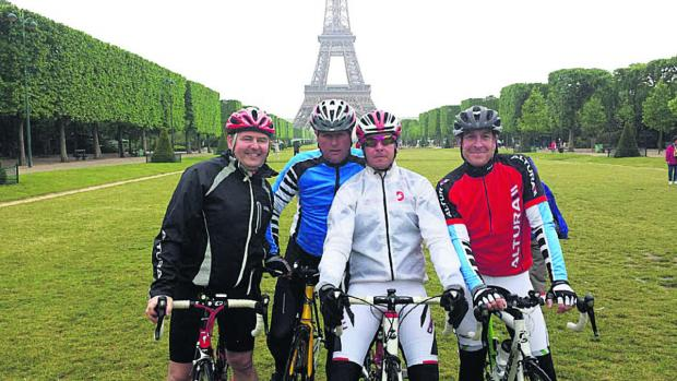 Fundraising father Stephen Baker, second left, arriving within sight of the Eiffel Tower in the centre of Paris on his sponsored bicycle ride with, from left, Kevan Haines, Gary Harris and Paul Rumming