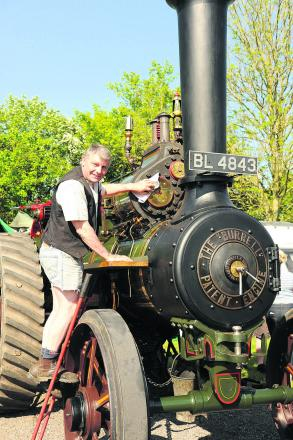 Colin Hatch polishes his 1901 Burrell steam engine, on show at Castle Combe