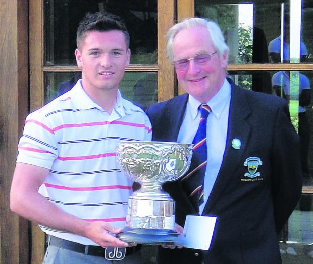 Ben Amor receives the county championship trophy from Wiltshire president Barrie Reardon Smith (Photo: Wiltshire Golf Union)