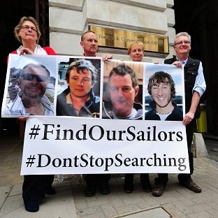Relatives of the missing yachtsmen press for the search to continue