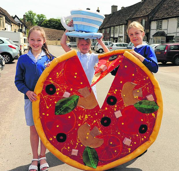 The Wiltshire Gazette and Herald: Lacock School pupils Charlotte, Erin and Olivia with some of the creations for the bank holiday scarecrow trail