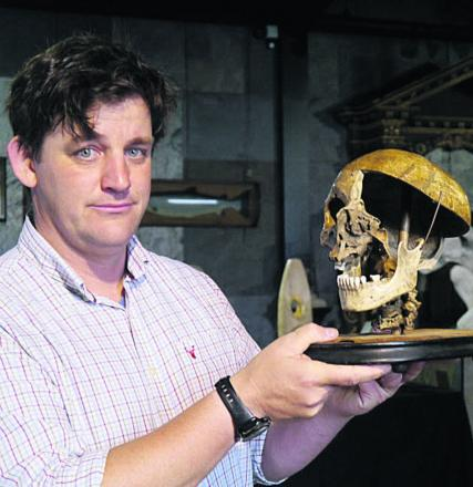 Specialist Rupert van der Werff with the felon's skull which sold for £2,500