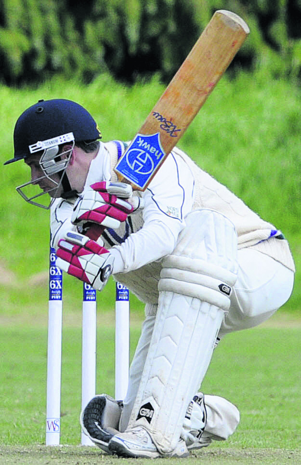 Marlborough batsman Dylan Bennie hits a boundary on his way to a century in his side's victory at Trowbridge on Saturday