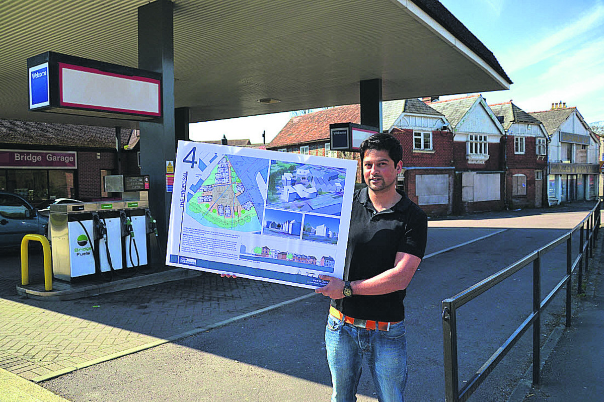 Alex Dean, with the plan for homes on the Bridge Garage site, which have now been approved, along with ones for derelict cottages