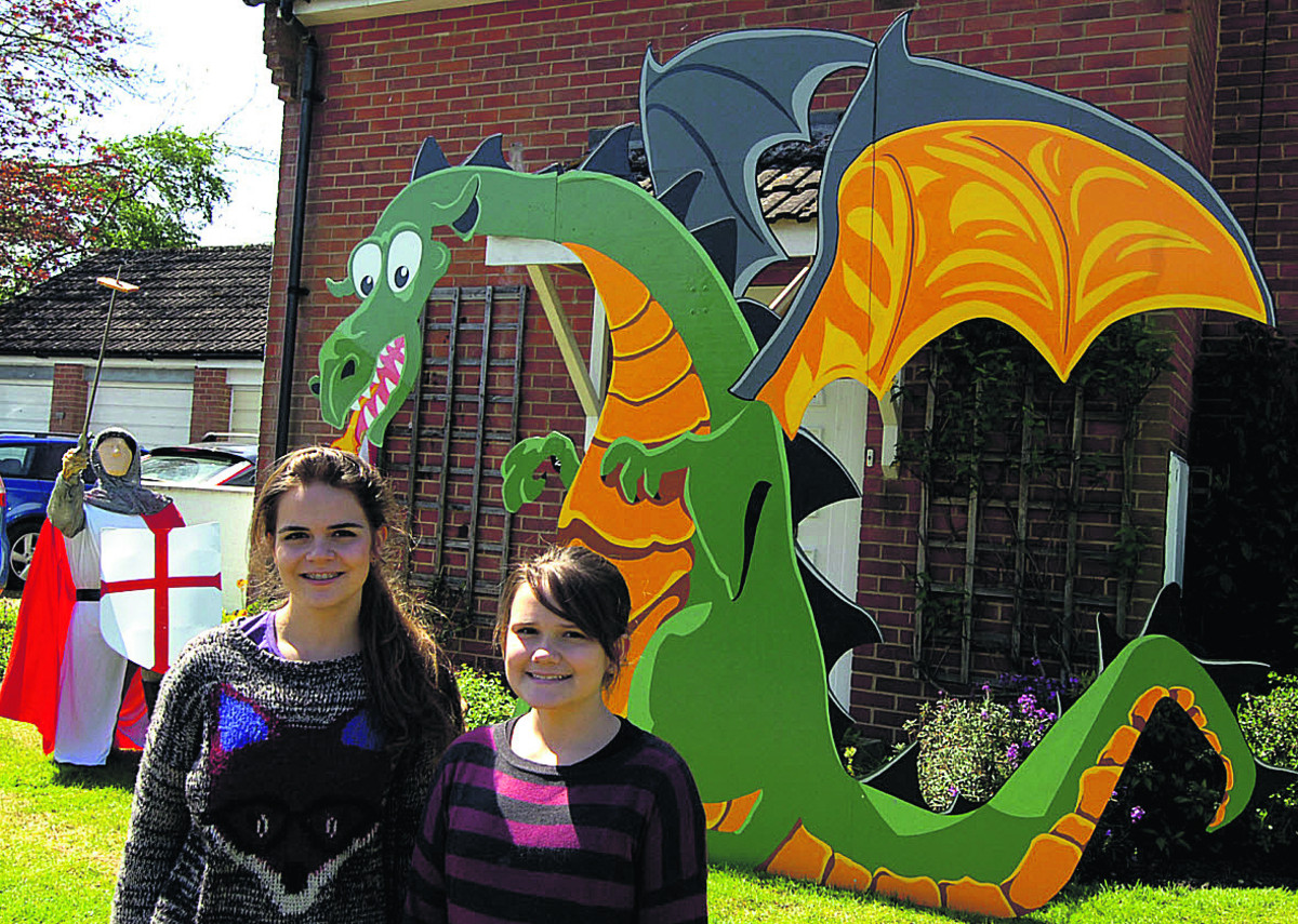Laura and Anabel at the Urchfont Scarecrow Festival with winning creation George And The Dragon            (PM1227) By Paul Morris