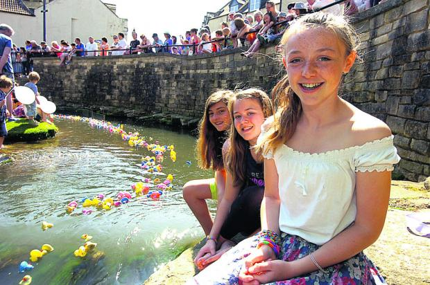 Ery, Charlotte and Isabelle in a prime position to watch Calne Duck Race