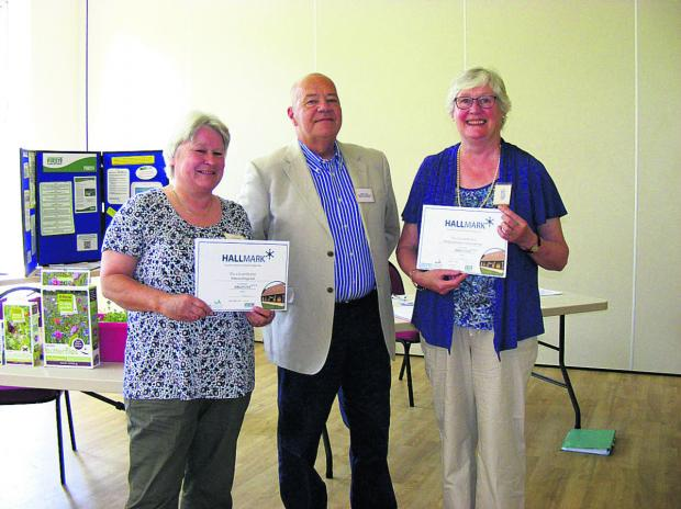 Aileen Farmer and Nesta Pudney are awarded their certificates by Brian Clake