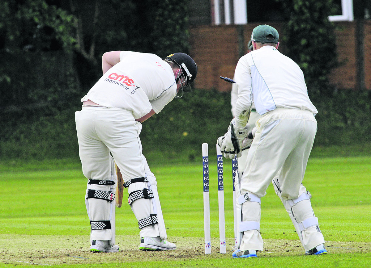 Wiltshire keeper Adam Miles watches as Wales' TJ Baker is bowled