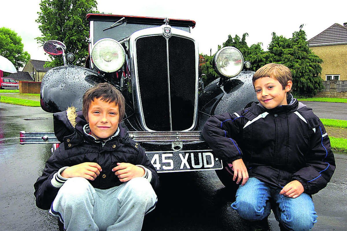 Louie and Cai with a Morris 8 at the classic car show held at Lady Evangelical Church in Chippenham