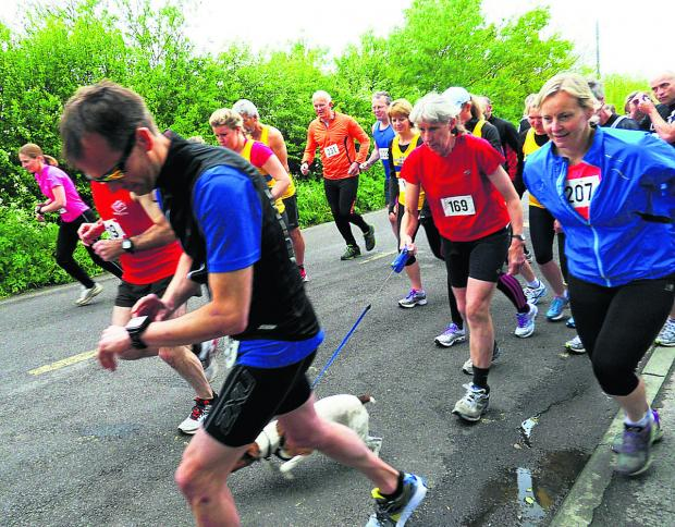 Those taking part in Dauntsey Cancer Research Run get going