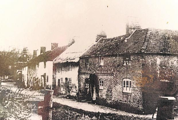 The Wiltshire Gazette and Herald: Imber High Street before the MoD took over