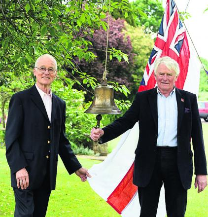 Robin Mitchell and his neighbour Ian Richards with the bell at Wyatt Court, Devizes, today