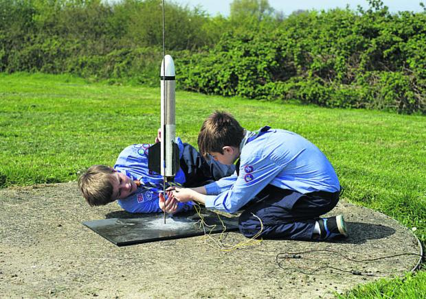 Jean-Benoit, left, and Joe of 10th Chippenham Air Scouts prepare their rocket for firing