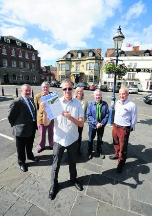 Trust For Devizes members John Baumber, left, Peter Allfrey, David Dawson, Philippa Morgan, John Girvan and James Flood with the survey into free parking