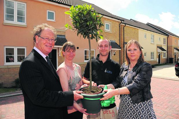 Toby Sturgis, Wiltshire Council cabinet member for strategic planning, with residents Jane and Dean Aitken and Green Square chairman Hilary Gardner at the new Spring Tinings estate