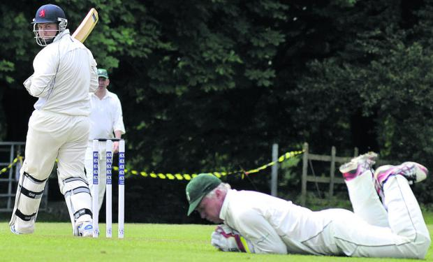 Winsley wicketkeeper Kevin Hendy dives to stop Haydn Amor's edged shot for Burbage