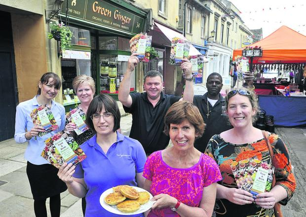 The Wiltshire Gazette and Herald: Clare Walsh with her Corsham Tarts and traders, from left, Christine Clancy, Yvette Hartley, Michael Thomas and Clarence Charlton and organiser Eleanor Trueman, right, promote the food festival