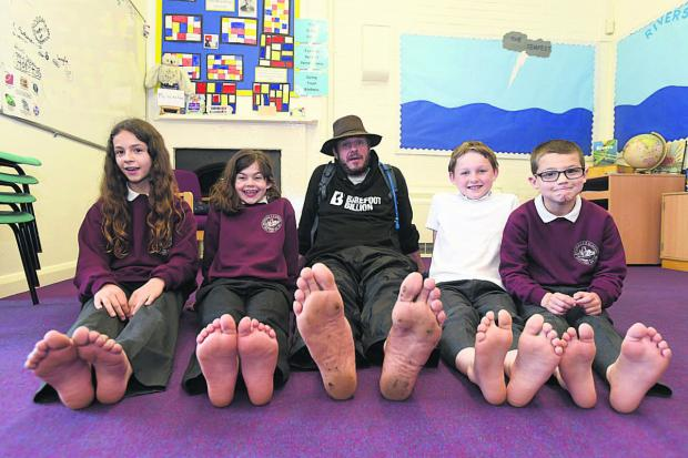 Pupils at Rushall School meet poet and fundraiser Philip Wells during his 1,000-mile barefoot trek                (DV1353) By Diane Vose