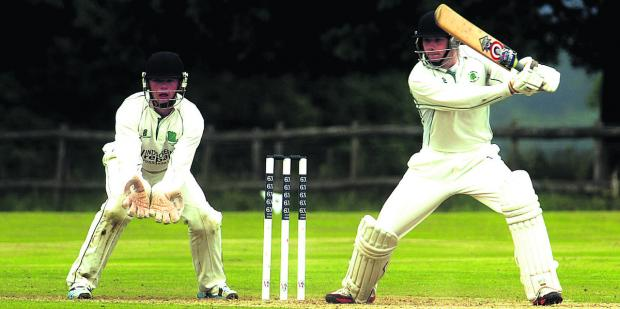 Marlborough's George Penfold in batting action, watched by Calne wicketkeeper Jordan Butler during their Wiltshire Division match on Saturday Pictures by Paul Morris (PM1304-0)