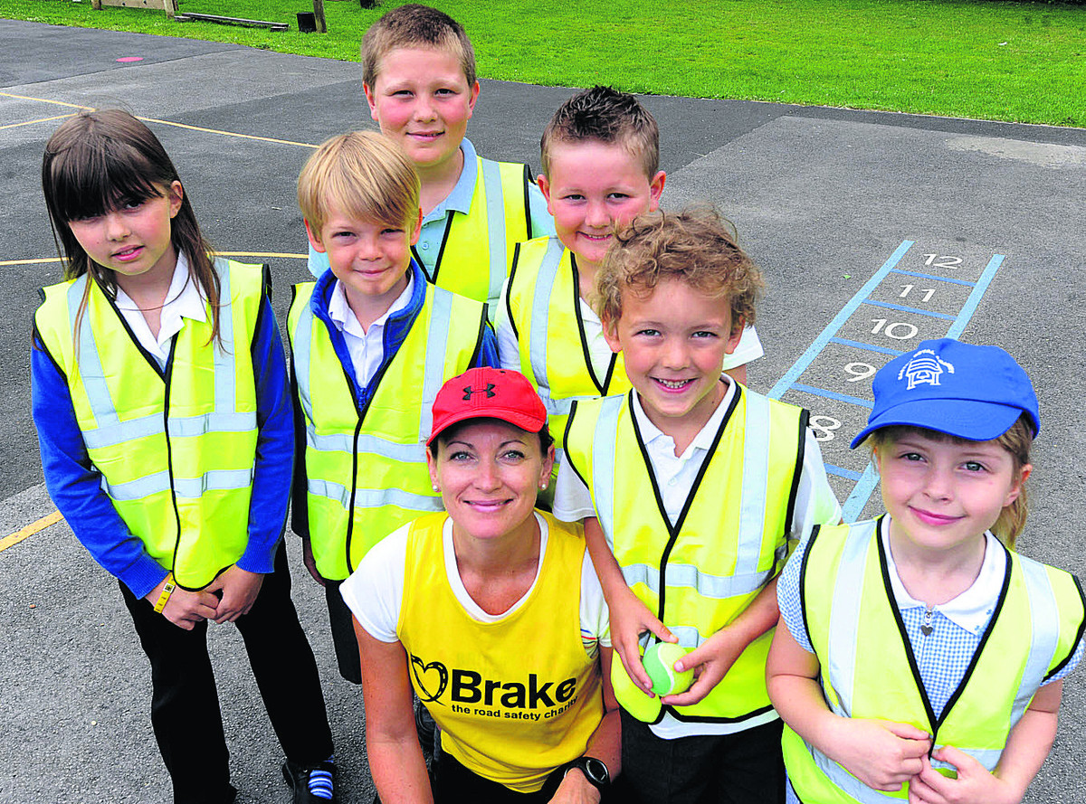Elaine Owen with sons Harrison and Tyler and fellow Easton Royal Primary School pupils Hailey, Tom, Charlie and Imogen
