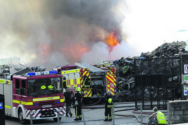 The Wiltshire Gazette and Herald: The fire still burning at the scrapyard at 6pm on Saturday evening. Picture by Trevor Porter