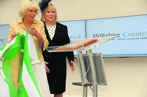 The Wiltshire Gazette and Herald: The Duchess of Cornwall unveils the plaque commemorating the opening of County Hall today watched by council leader Jane Scott. Picture by Trevor Porter