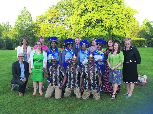 Wiltshire Community Foundation's Rosemary Macdonald, right, and Kate Robinson, back left celebrate with Swindon Gospel Choir and Community Foundation staff