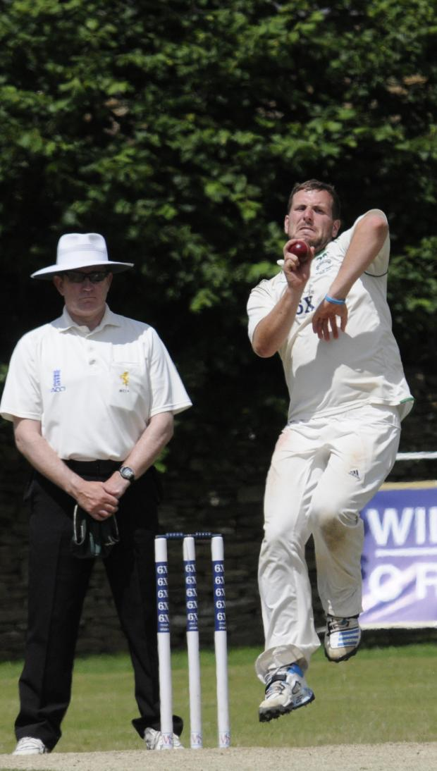 The Wiltshire Gazette and Herald: Jake Roberts, who took eight wickets in total against Dorset, bowls on day three