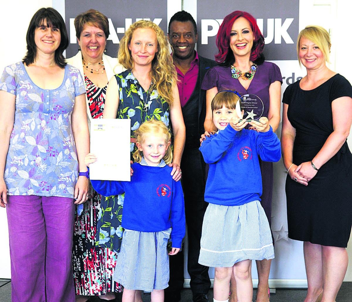 Fi Picton, Lorraine Petersen OBE, awards' chair and PTA-UK vice chair, Kirsty Strachan, TV presenters David and Carrie Grant, Alison Davies, of sponsors Liberty Mutual Insurance, and, front, Jess Picton and Grace Strachan with the certificate and award
