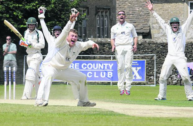 Wiltshire wicketkeeper Adam Miles celebrates the wicket of last Dorset batsman James Hayman which confirmed the home side's victory