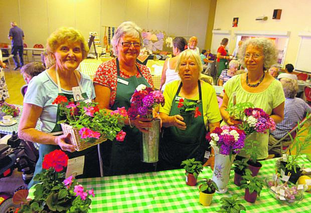 Shirley Long, Viv Olson, Annette Jefferies and Cheryl Underhill                sell plants in the Bouverie Hall market                  (pm1321) By paul morris