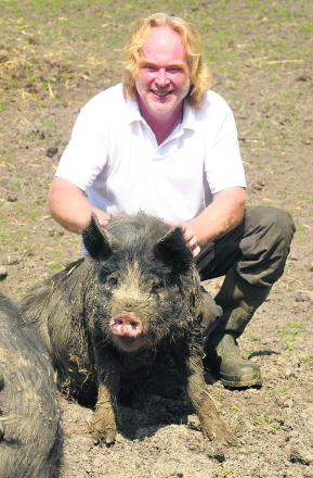 Robert Buttle and wife Sara are building up their herd of a rare breed British pigs in Compton Bassett