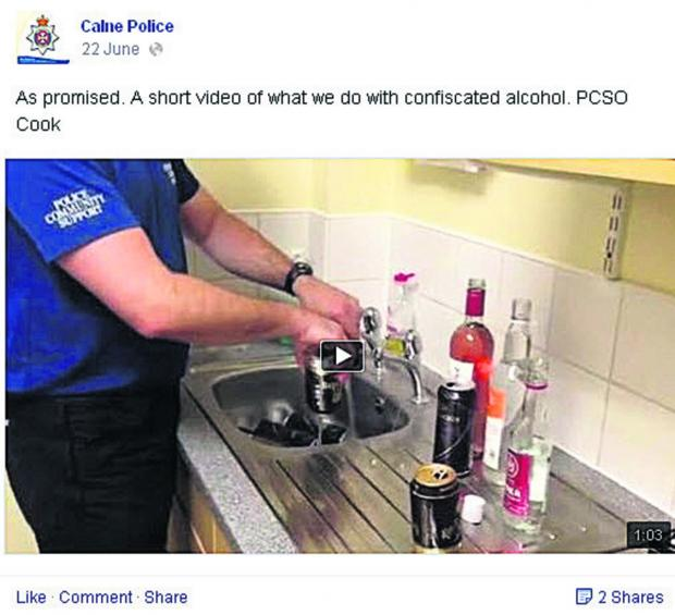 The Wiltshire Gazette and Herald: Calne PCSO Mark Cook pours away the confiscated alcohol