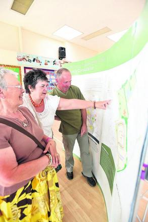 From left, residents Frances Snell, Carol Porteous and Michael Bright look at the plans