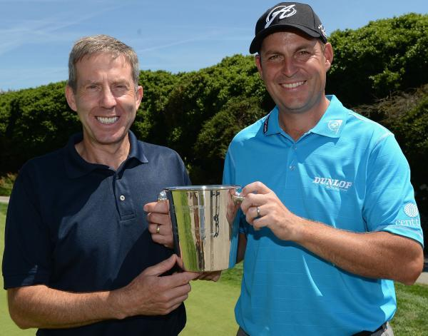 David Howell (right) is presented with an engraved ice bucket by Keith Waters, The European Tour's Chief Operating Officer