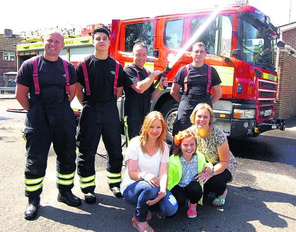 Niki Conner, Liz Grey with daughter Isobel, and Nick Borritt, Zac Messenger, Mark Hillier and Andy Olsen at Pewsey fire station