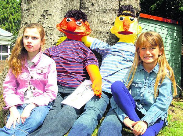 The Wiltshire Gazette and Herald: Courtney and Jaylea with some of the scarecrows at the fete. Picture by Paul Morris