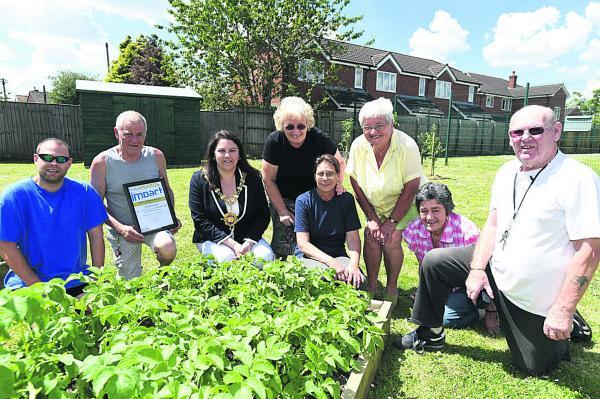 Residents and community garden committee members in front of their Waiblingen Way garden, Darren Pickford, Richard Arnold, mayor Sarah Bridewell, Sue Bryant, Carol Pickford, Val King, Coun Jane Burton and committee chairman Ray Snell