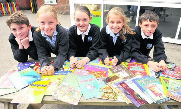 The Wiltshire Gazette and Herald: Bishops Cannings School pupils have won 100 books after reading more than 900 books in a national challenge. From left are Arthur, Chloe, Chloe, Sapphire and Lenny. (VS443) Picture by Vicky Scipio