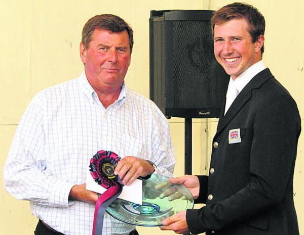 David Doel receives his CIC** prize from the Barbury Estate's Nigel Bunter