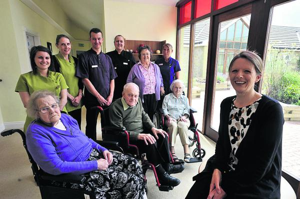 Jodie Llewllyn, right, with staff and residents
