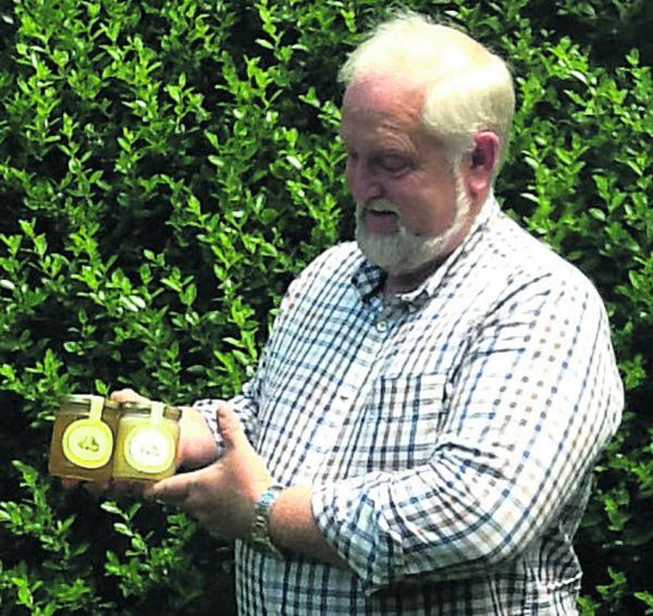 The Wiltshire Gazette and Herald: Fred Swift, the Wiltshire Beekeeper, with jars of honey