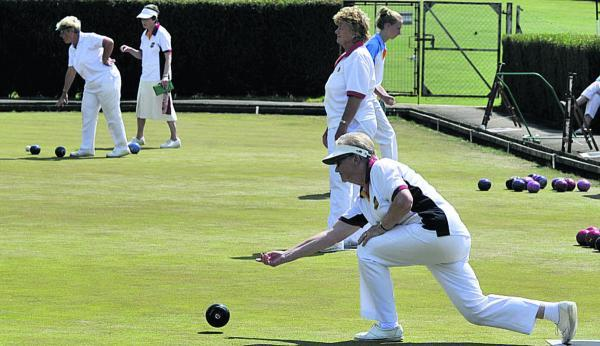 The Wiltshire Gazette and Herald: Devizes' Sheila Garlick bowls during Saturday's ladies pairs matches at Bradford on Avon, with (background l-r) Janet Willis (Stratton Churchway), Susan Long (Devizes), Katy Smith (Wootton Bassett) and Viv Baskerville (Chippenham Town)